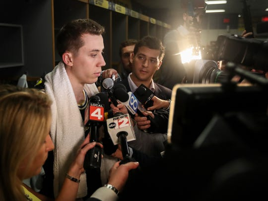 Duncan Robinson talks to the media in the locker room after losing the national championship game.