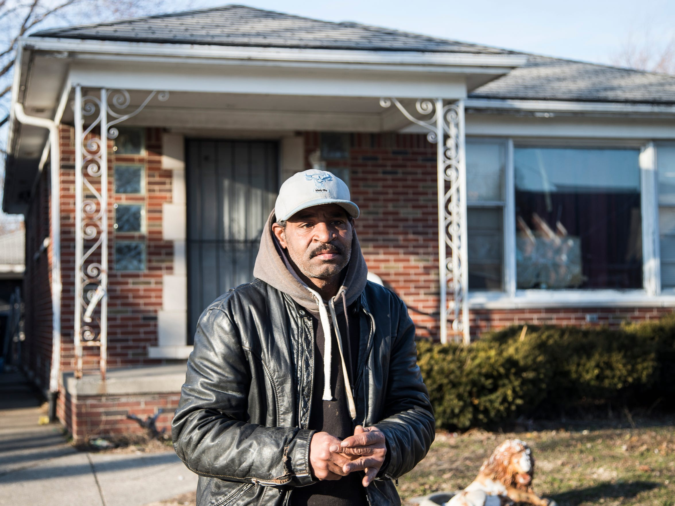 Reginal Murphy in front of the home he occupies on Fairmount Drive in Detroit, Tuesday, February 27, 2018.