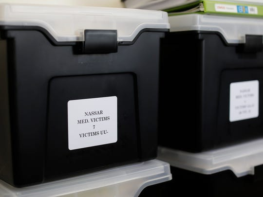 Black boxes containing hundreds of files from the investigation of Larry Nassar line a wall in Assistant Attorney General Angela Povilaitis' office in Detroit on Tuesday, Feb. 13, 2018.