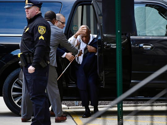 Bill Cosby nearly stumbles getting out of car as he