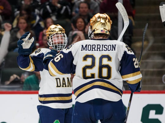 Notre Dame Fighting Irish Forward Andrew Oglevie (15) celebrates his goal in the second period against Michigan Wolverines in the 2018 Frozen Four college hockey national semifinals at Xcel Energy Center on April 5, 2018.