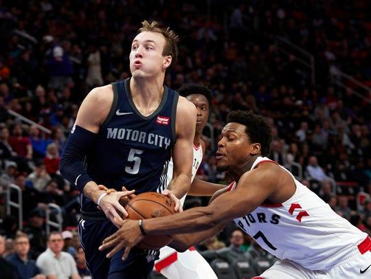 Toronto Raptors guard Kyle Lowry (7) strips the ball