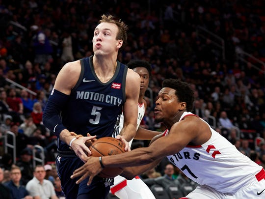 Toronto Raptors guard Kyle Lowry (7) strips the ball