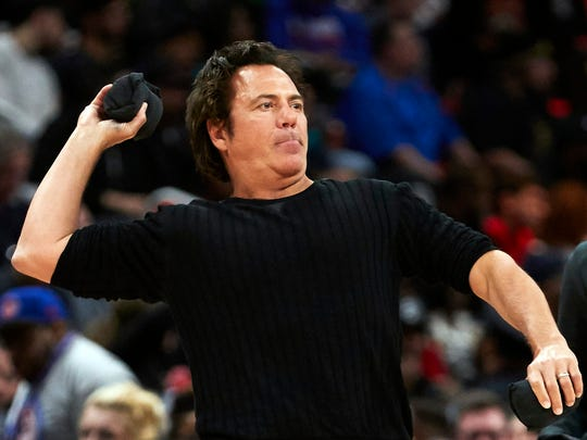 Tom Gores throws a shirt into the crowd at Little Caesars Arena on April 9.