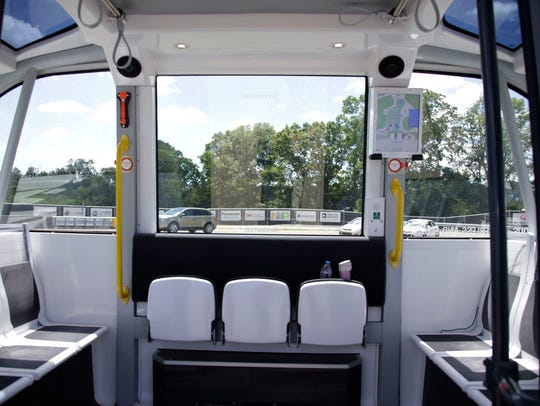 The interior of a driverless shuttle made by NAVYA