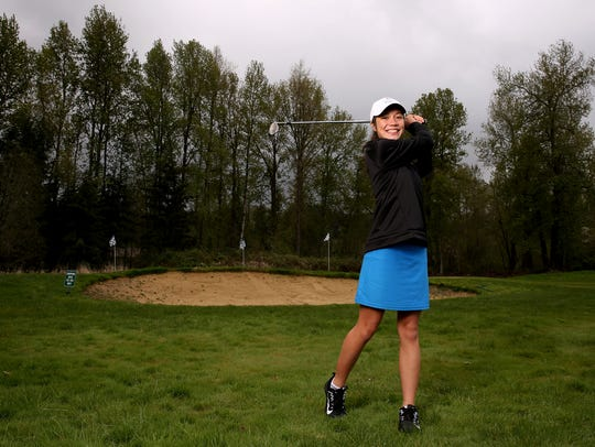 Ashley Zhu, practicing at Salem Golf Club, tied for