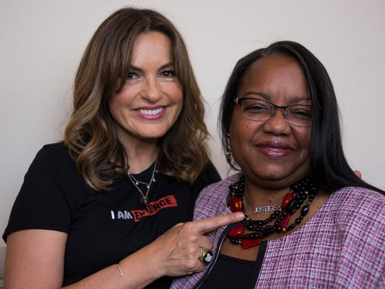 Mariska Hargitay, left, points to a necklace she just