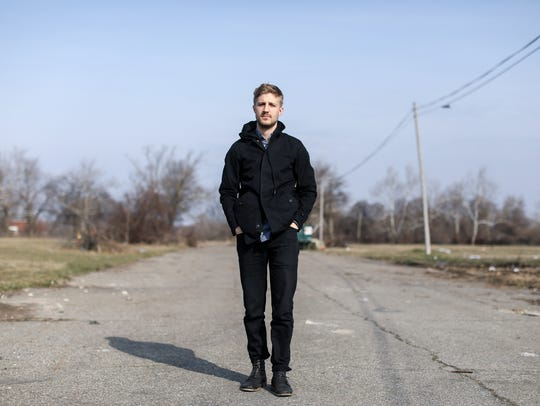 """Ryan Clancy, 24, of Highland Park stands in an empty lot off of Connor Street at Franfort Street near Chandler Park on the east side of Detroit on Friday, April 13, 2018. Clancy made a documentary called """"Hallow,"""" about the death of Damon Grimes. The 15-year-old crashed into a parked truck and died after a Michigan State"""