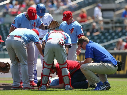 Trainers tend to Memphis Redbirds starting pitcher Daniel Poncedeleon, who was struck in the head by a ball on May 9, 2017, during a game against the Iowa Cubs in Des Moines.