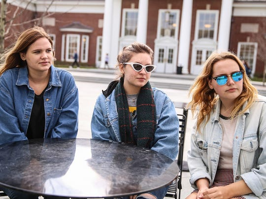 Students Natalie Brunini (from left), Kathleen Banek and Emma Wittkowski talk about tension on campus at DePauw University.