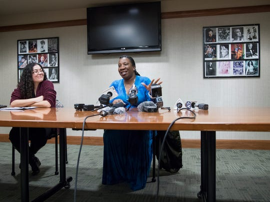 Tarana Burke, founder of the #MeToo movement, center, answers a question during press conference before her speech at Michigan State University's Wharton Center in East Lansing, Thursday, April 19, 2018. Next to her is Xhercis Mendez, assistant professor at MSU's Department of Philosophy, and African American and African Studies Program.