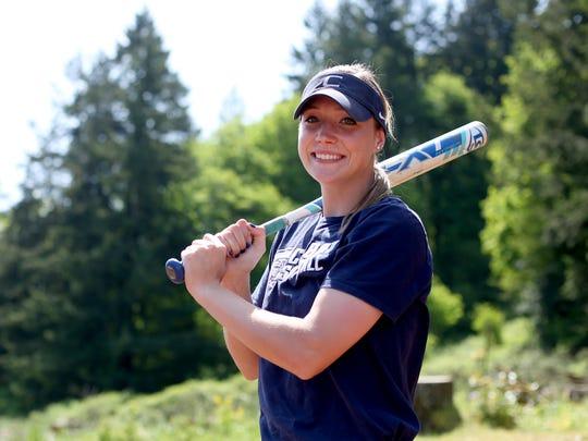 Corban right fielder Jessie Isham, a Sprague High graduate,