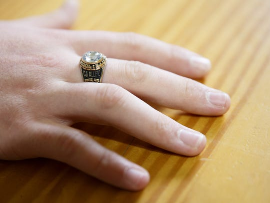 CJ Larsen, 18, wears a class ring for Roberts High School at his home in Salem on Wednesday, April 18, 2018. Larsen required special education and attended Sprague High School, then dropped out and earned his GED through the Downtown Learning Center.