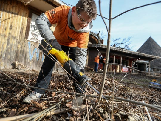 Landon McGowan, 11, volunteers with Saurbier Law Firm to help clean up the closed Belle Isle Zoo, during the Belle Isle Spring Clean Up 2018 at Belle Isle state park on Saturday, April 21, 2018. The Belle Isle Conservancy kicked off the anti-litter campaign 'Keep Belle Isle Beautiful' at this year's annual Spring Clean Up.