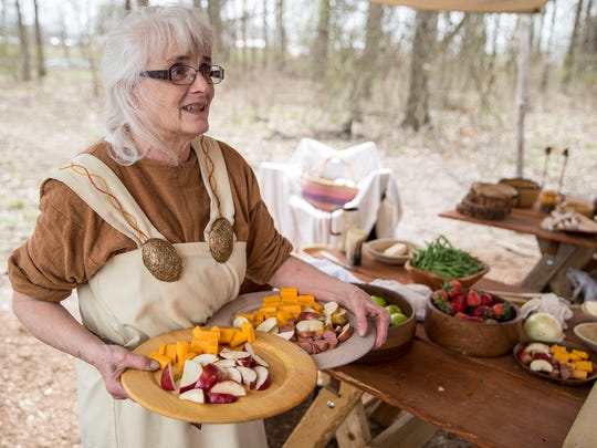 Amy Gooch sets up lunch for fellow members of Norsemen of Michigan living history group, during Viking Fest in Whitestown, Ind., Saturday, April 21, 2018. The three day festival celebrates viking culture through demonstrations, performances and cuisine and is open Sunday, April 22, from 10 a.m. to 2 p.m.