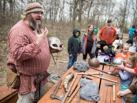 "Seth Gooch runs the ""petting zoo,"" a table of viking gear for attendees to hold and wear, during Viking Fest in Whitestown, Ind., Saturday, April 21, 2018. The three day festival celebrates viking culture through demonstrations, performances and cuisine and is open Sunday, April 22, from 10 a.m. to 2 p.m."