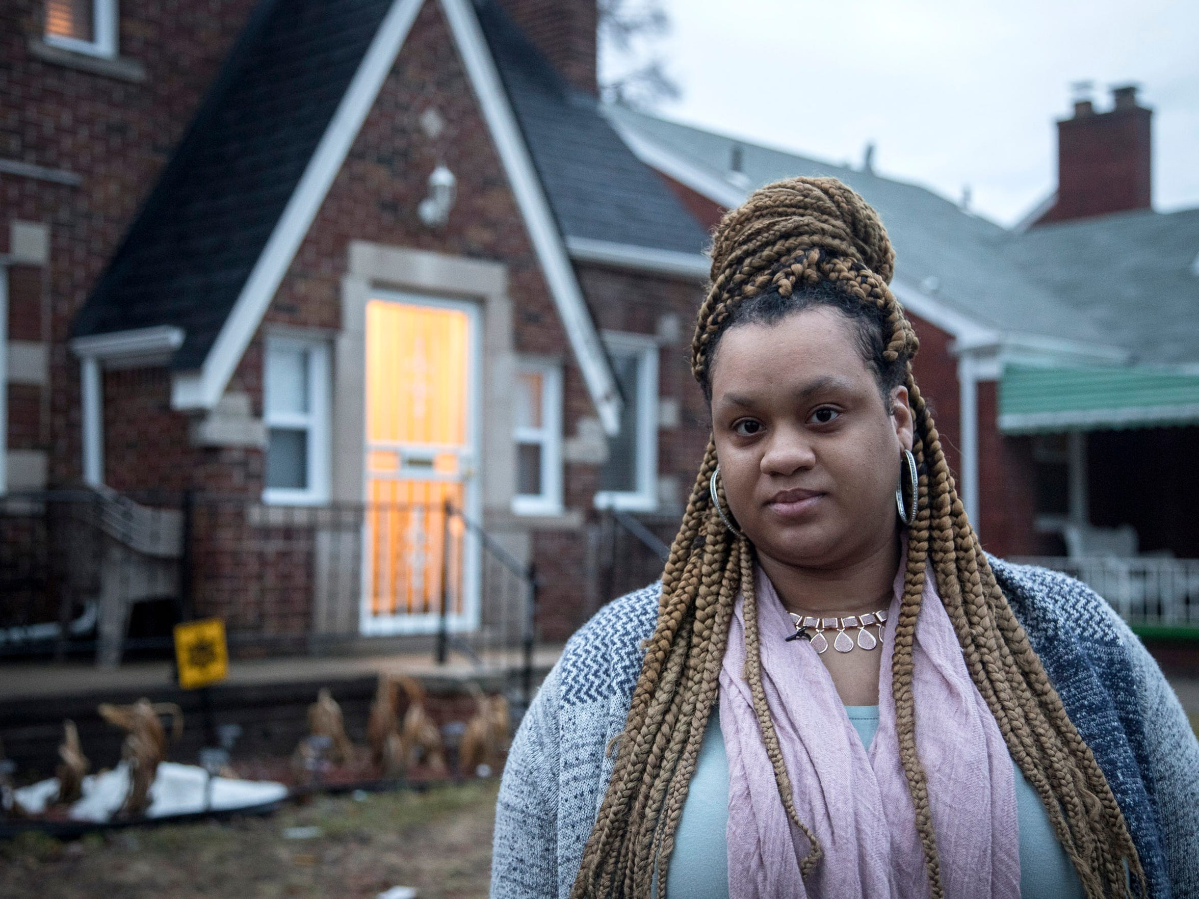 Rachel Yancey of Detroit in front of her former home in Detroit, Tuesday, February 20, 2018.