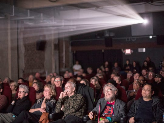 "The audience watches ""Last Days of Chinatown"" on the screen at Cinema Detroit during the Freep Film Festival in Detroit, Friday, April 13, 2018."