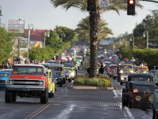A variety of classic vehicles parade along Hilltop