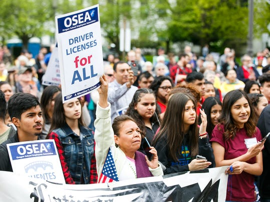 About 300 people gather at a May Day rally on Tuesday, May 1, 2018 at the Oregon State Capitol. At this year's event, Gov. Kate Brown signed Senate Bill 1563 and House Bill 4111. Senate Bill 1563 allows undocumented students to continue getting access to lower tuition costs, scholarships, and other financial aid; House Bill 4111 allows the DMV to renew and replace driver's licenses for DACA and Temporary Protected States recipients.