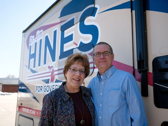 Republican gubernatorial candidate Dr. Jim Hines, a Saginaw physician and his wife, Martha Hines, outside his mobile campaign vehicle while parked in Saginaw on Friday, April 20, 2018.
