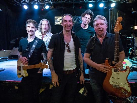 From left, Sponge guitarist Joey Mazzola, bassist Tim