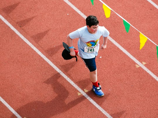 Fourth graders Zander Geck approaches the finish line