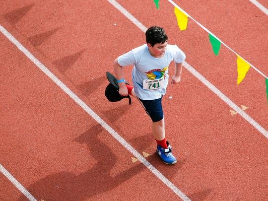 Fourth graders Zander Geck approaches the finish line at the 36th annual Awesome 3000 on May 5, 2018, at McCulloch Stadium in Salem, Ore.