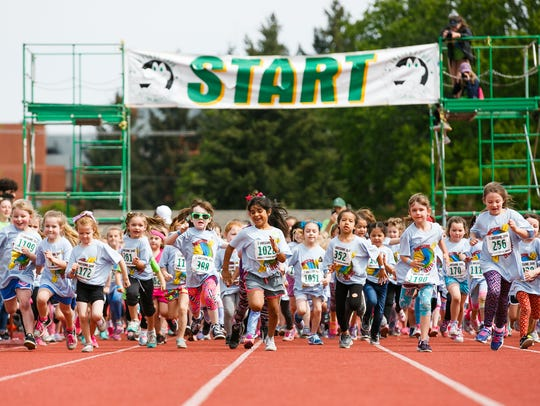 Kindergarten girls run in the 36th annual Awesome 3000