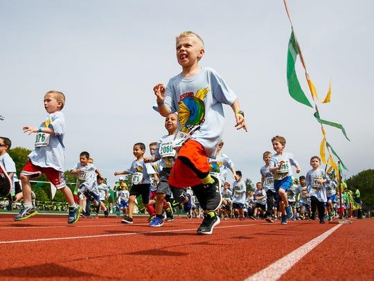 Jackson Baldwin and other kindergarten boys run in