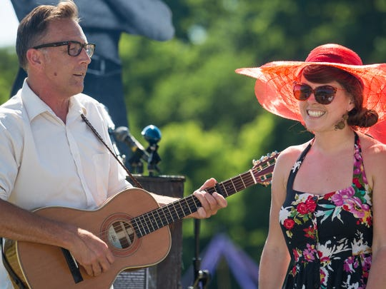 Musicians Brett Hughes and Kat Wright perform during the Precipice press event held behind Burlington College on Monday, July 15, 2013.