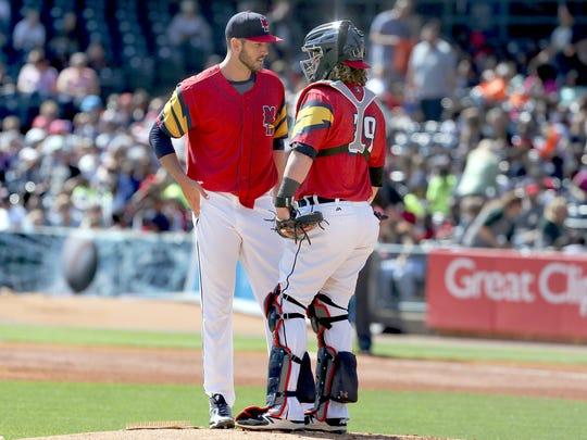 Mud Hens pitcher Drew VerHagen, left, and catcher Jarrod Saltamacchia speak on the mound on Tuesday, May 8, 2018, against the Columbus Clippers in Toledo.