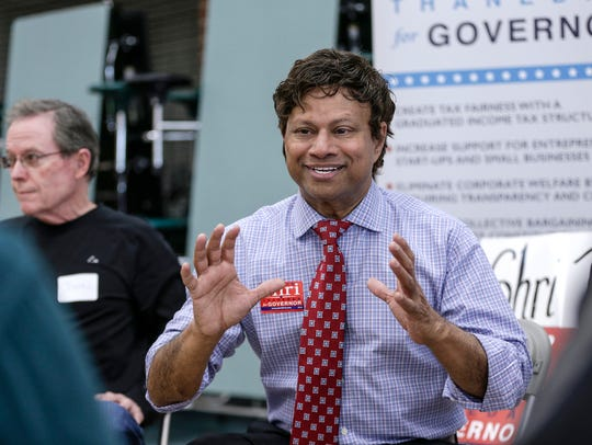 Governor candidate Shri Thanedar talks to voters during