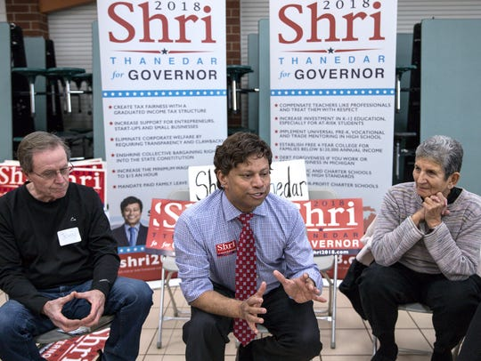 Governor candidate Shri Thanedar, center, talks to