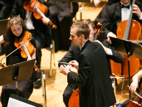 South Salem High School's Ben Stokes directs the orchestra
