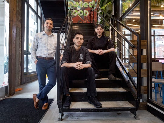Owner Sam Abbas, 31, left, Zane Makky, 28, executive chef overseeing both locations, and Ray Rahal, chef, are photographed at the new location of Brome Modern Eatery in downtown Detroit.