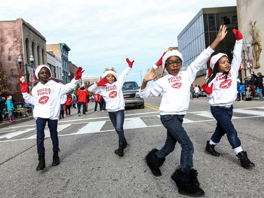 Delta Gems perform during the Holiday Extravaganza parade in downtown Pontiac on Saturday, Dec. 2, 2017.