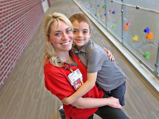 Lauren Harper hugs her son Tyler in Riley Hospital for Children's Pre and Post Op unit, Wednesday, May 9, 2018.   When her son was 1 month old, he was admitted to Riley Hospital.  Harper was so impressed with the nurses who treated her son like their own, that she decided to go back to school to become a nurse.  Now she works as an RN at the hospital.