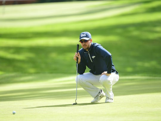 Grant Booth lines up a putt at the 2018 Mountain West Championship at the Gold Mountain Golf Club in Bremerton, Wash.