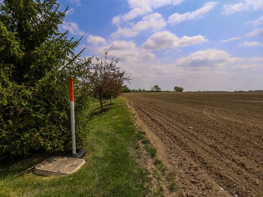 A southward view of 100 acres of farmland behind a