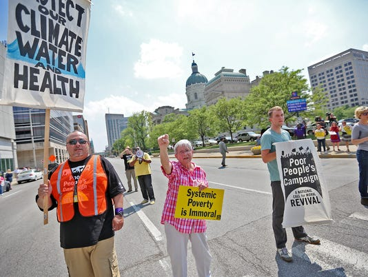 Poor People's Campaign in Indianapolis protest blocking Capitol Ave. by the Statehouse, part of a 38-state revival of the Martin Luther King protest in 1968,  resulted in 13 arrests, May 14, 2018.