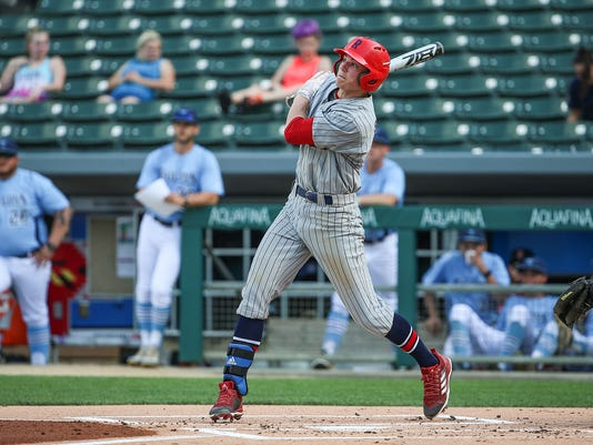 Roncalli Rebel Nick Schnell (7) hits a triple in the bottom of the first during the Marion County tournament final at Victory Field