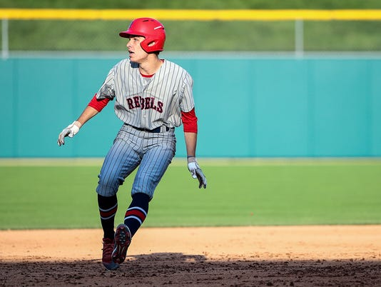 Roncalli Rebel Harrison Koppenhofer (20) runs a two-RBI double during Marion County tournament baseball final at Victory Field