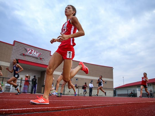 Elizabeth Stanhope finished the 800 meter run in 2 minutes, 10.16 seconds at a sectional track and field meet at Pike High School in Indianapolis, Tuesday, May 15, 2018. Stanhope has been home schooled her entire life, previously practicing twice a week with a home-schooled team. This year, the high school junior enrolled in one class at Pike, qualifying her to compete with the team. Her sectional time is fastest in the state this year, No. 11 in the nation and No. 6 in Indiana history.