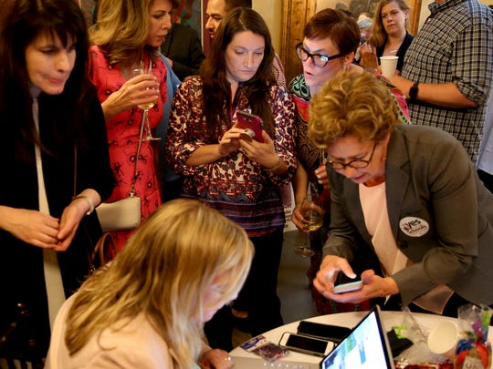 Supporters look for results during an election-night