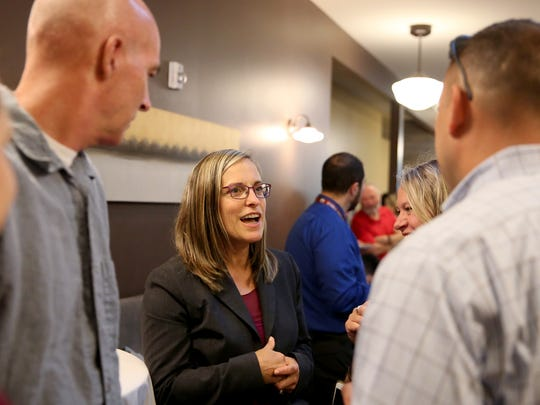 Superintendent Christy Perry talks with supporters during an election-night party to watch voter returns come in for the Salem-Keizer Public Schools bond measure at Amadeus in downtown Salem on Tuesday, May 15, 2018.