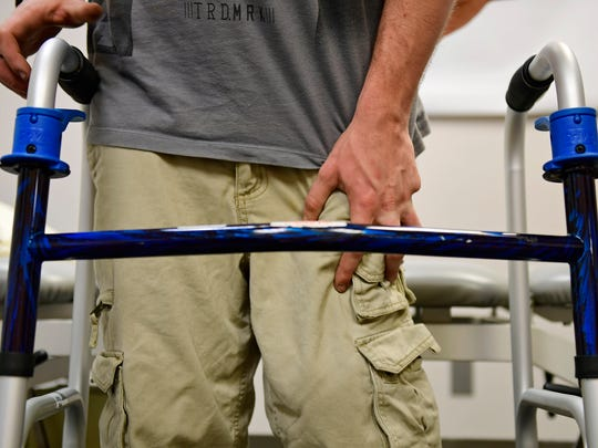 Mark Frahn works on squats during a physical therapy session at HealthSouth Rehabilitation Hospital of York on Thursday, March 1, 2018. Frahn fractured his L1 vertebrae after crashing his dirt bike on June 11, 2017. Doctors told him he wouldn't be able to walk again.