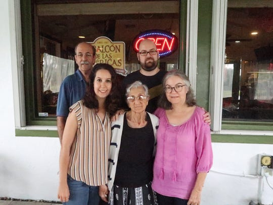 Amanda Abella (pictured) moved back home with her family after she graduated from college in 2010.  Top row L to R: Antonio Abella (dad), Antonio Abella (brother) Bottom row L to R: Amanda Abella, Emma Lamas (grandmother), Alina Artiles (mom)