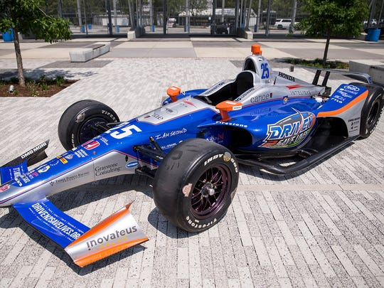 About 25 Hoosiers awaiting organ transplants and their families helped reveal the number 25 Driven2SaveLives Honda that Stefan Wilson will drive in the Indianapolis 500, at Indianapolis Motor Speedway, Monday, May 14, 2018. IndyCar driver Stefan Wilson, the Indiana Donor Network, Andretti Autosport and sponsor Intelisys led the unveiling.