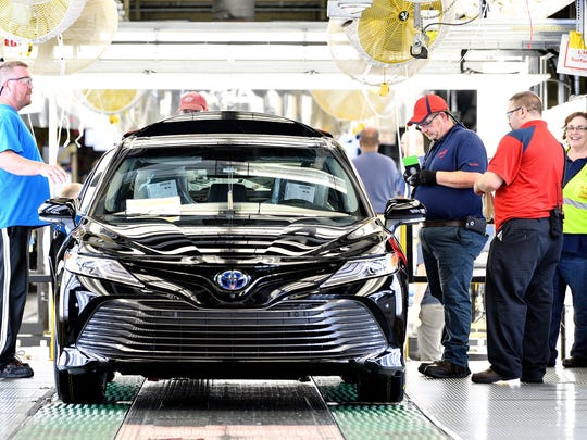 Team members inspect one of the first 2018 Toyota Camrys